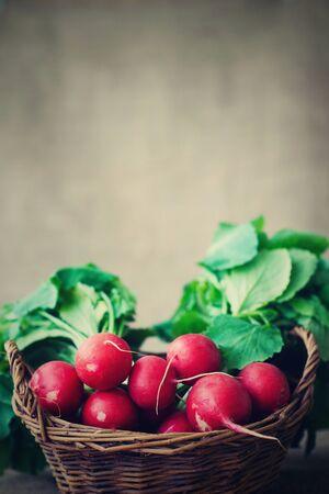 wooden basket: red radish in a wicker basket