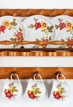 shelves with painted cups on a plate Stock Photo