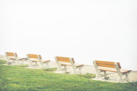 empty bench on misty lake