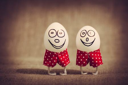 red shorts: Happy decorative Easter eggs in red shorts Stock Photo