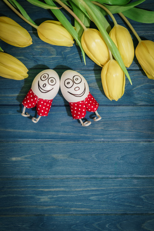 red shorts: smiling easter eggs in red shorts with flowers background tulips