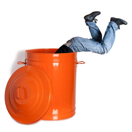 boy dives into a garbage can photo
