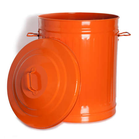 An orange, vintage garbage with lid on the side photo