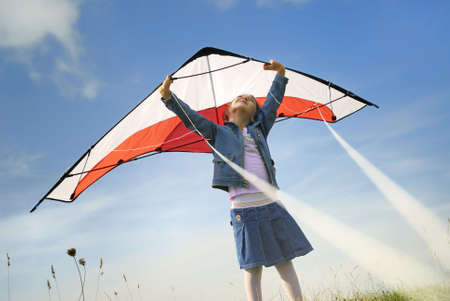 child dreaming to fly with a kite Stock Photo