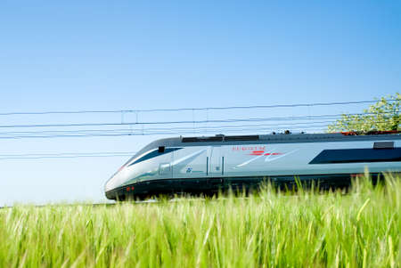 eurostar: italian Eurostar train running beside the cultivate lands