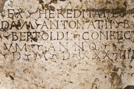 smudgy: ancient plaque with latin inscription