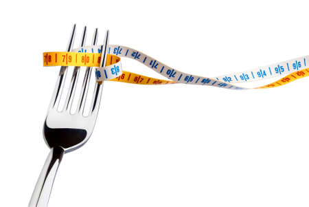 fork and measuring tape for a healthy lifestyle Stock Photo - 3309767
