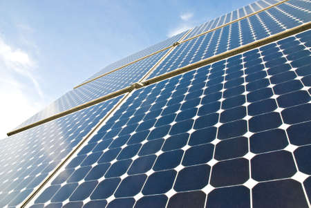 solar panels against a serene blue sky Stock Photo