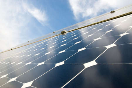 electric cell: close view of solar panels against a serene blue sky