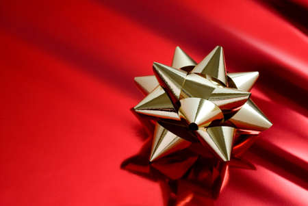christmasy: golden cockade on red parcel paper