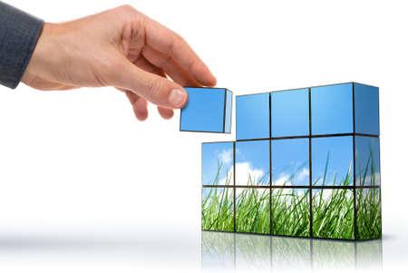 sustentabilidad: lado la creaci�n de un panorama de hierba contra el cielo azul