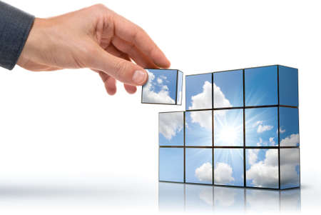 hand building up a sunny sky with white clouds Standard-Bild