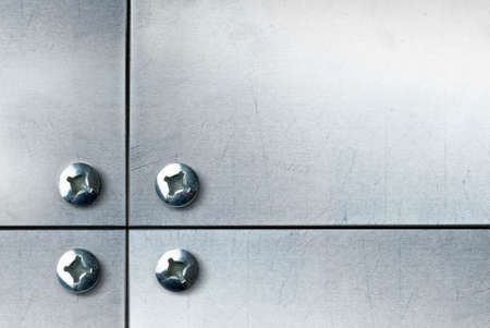 metallic plate with screws