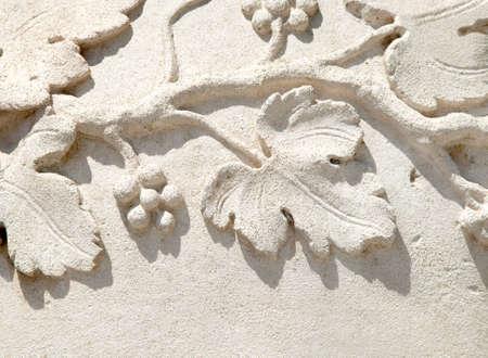italian grapevine bas relif on stone Standard-Bild