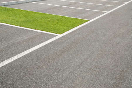 parking space: green area, of grass, instead of carpark