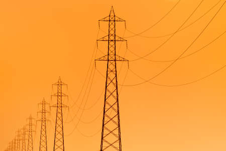 pylons supporting overhead electricity conductors for electric power transmission photo