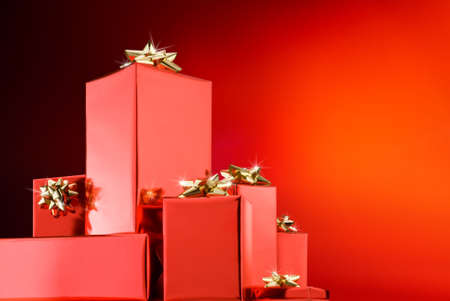 christmas boxes over red background