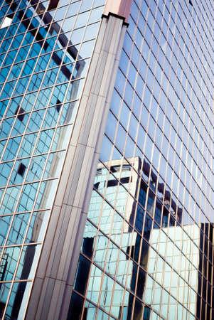 suggestive: skyscraper reflected in skyscraper with suggestive color hues