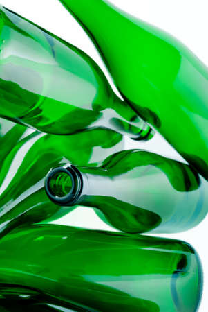 disordered: heap of green glass bottles ready for recycling