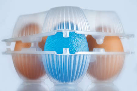 genetically engineered: eggs package, the blue egg stands for GMO food Stock Photo