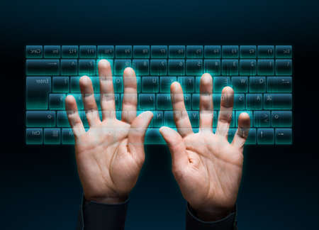 modernity: hand typing in on a virtual keyboard interface Stock Photo