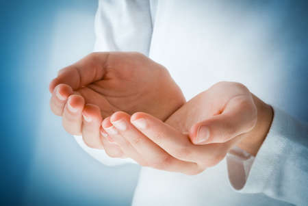 offerings: empty hands in the act of receiving something