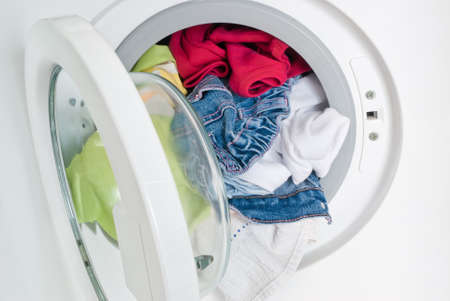 washing machine with colorful clothes inside photo