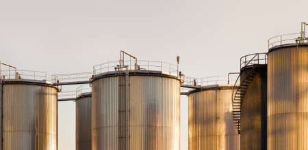 large tanks for petrol and oil at the sunset Standard-Bild