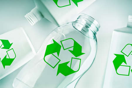 waste products: plastic containers with the green recycle symbol