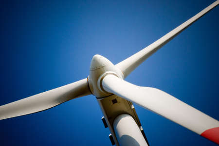 energy supply: closeup of a wind turbine against the blue sky Stock Photo