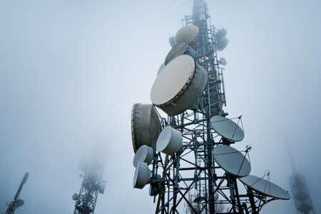 通信: 雲の中に通信塔 写真素材