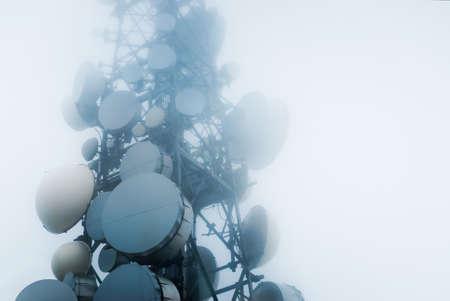 雲の中に通信塔 写真素材