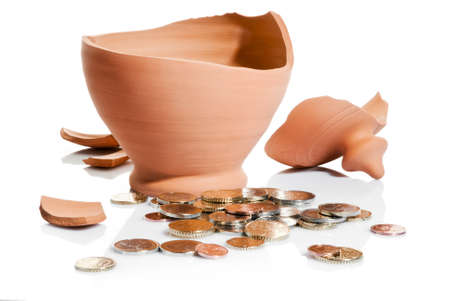 downturn: moneybox crashed and coins isolated over white background
