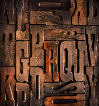 typesetter: old wooden type background