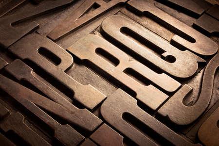 letterpress blocks: old wooden uppercase type in perspective