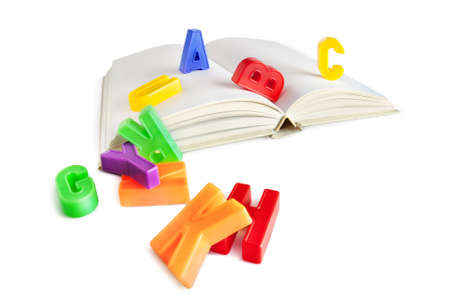 literacy instruction: alphabet letters on a book isolated on white Stock Photo