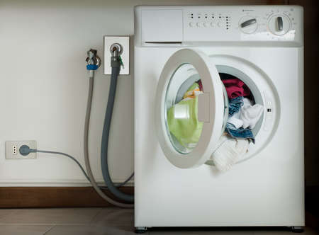 washing machine with colorful clothes photo