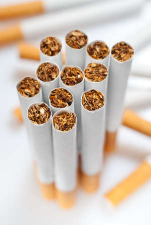 disposed: cigarettes disposed dirorderly over white background Stock Photo
