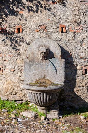 Susa, Italy. Februar 14th, 2021. Ancient fountain in Via degli Archi. Éditoriale