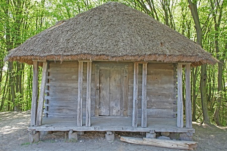 Ancient traditional ukrainian rural cottage with a straw roof photo