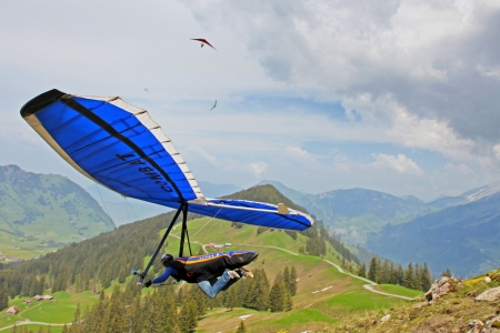 gliding: SANTS, SWITZERLAND - May 27: Competitor  Ievgen Lysenko from Ukraine of the Swiss Masters hang gliding competitions takes part on May 27, 2012 in Sants, Switzerland
