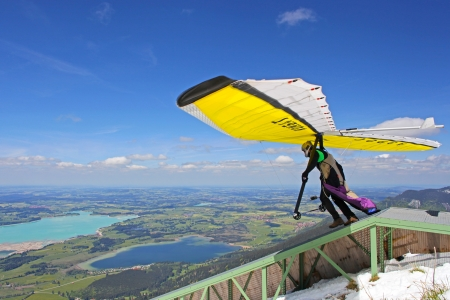 gliding: TEGELBERG, GERMANY - MAY 16: Competitor Conrad Duvig from Austria of the King Ludwig Championship hang gliding competitions takes part on May 16, 2012 in Tegelberg, Germany Editorial