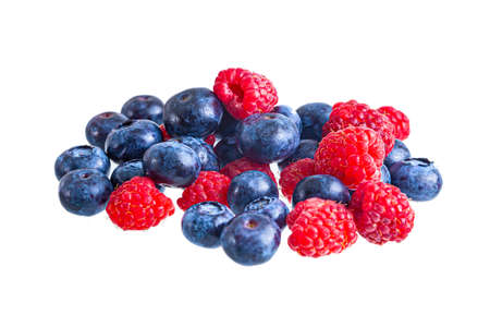 Fresh bright raspberries and blueberries heap isolated