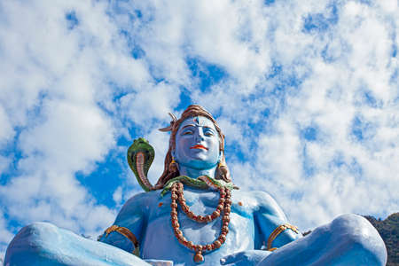 Statue of Lord Shiva on the Ganga river bank in Rishikesh