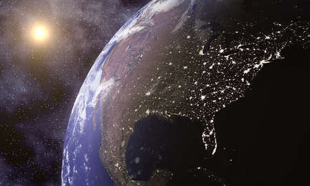 Planet Earth in space with city lights visible on the Eastern coast of America  Stock Photo