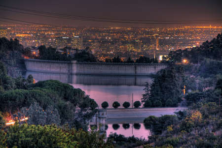 The lights of Los Angeles behind the Los Angeles reservoir.