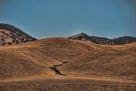 earthquake crack: A crack in the hills of central California made by an earthquake.