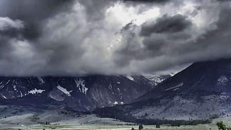 A rain storm with stormy skies over the eastern Sierra Nevada Mountains.
