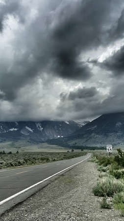 owens valley: A road leads into stormy eastern Sierra Nevada Mountains. Stock Photo