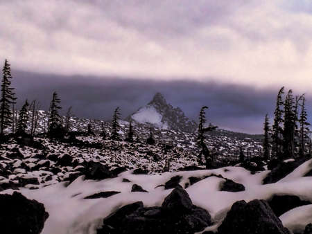 oregon  snow: A mountain in the distance of a snow covered lava field in Oregon. Stock Photo